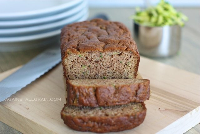 Almond Flour Zucchini Bread on a wood cutting board in home kitchen